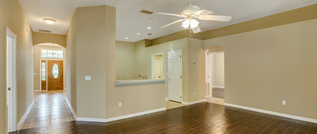 Living room area with wooden floor